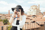 Anouk-govil-taking-picture-on-a-building