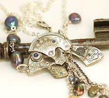 Clockwork Fish Steampunk Necklace by byrdldy