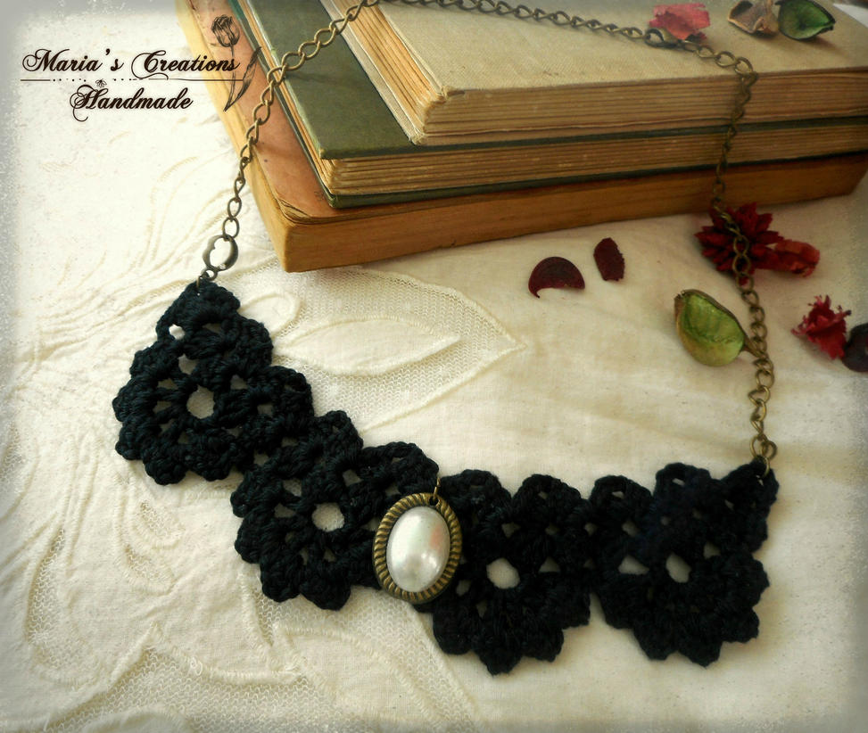 Black knitted necklace by marakigr