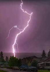 Lightning hits the town. by Flutterflyraptor