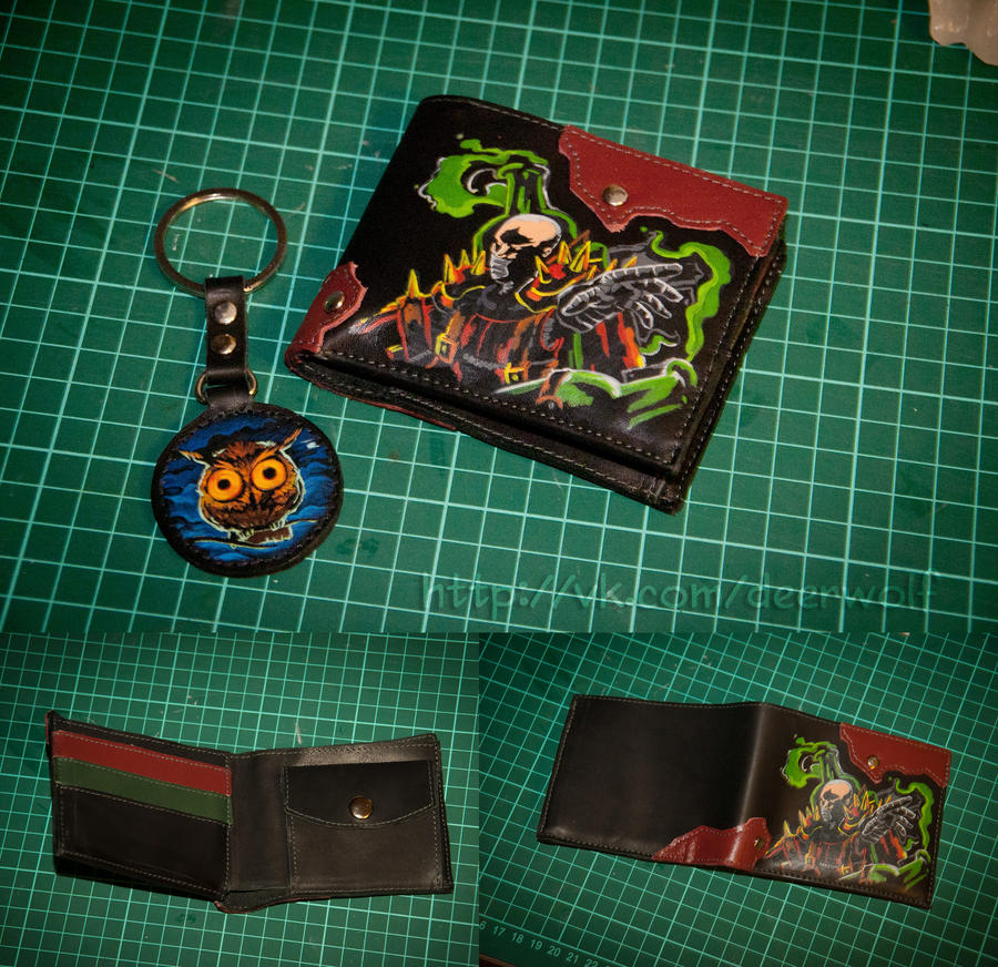 Singed wallet and a breloque by eiphen