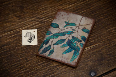 Leaves on the wind, passport cover