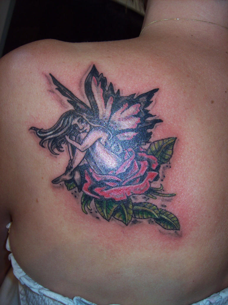 fairy sitting on a rose tattoo by drewcarcrazy