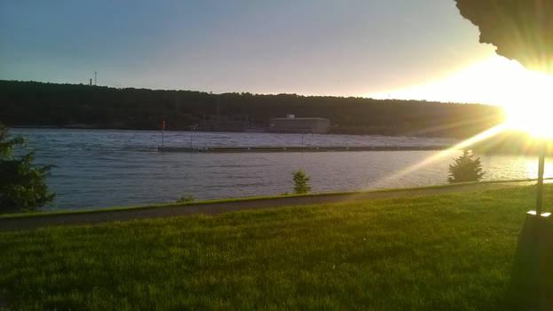 swolen river  (sun photo bomb)