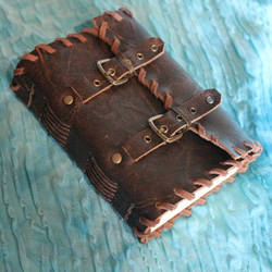 Handmade leather journal with buckles