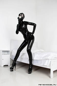 Black Latex Rubber Girl in a White Room.
