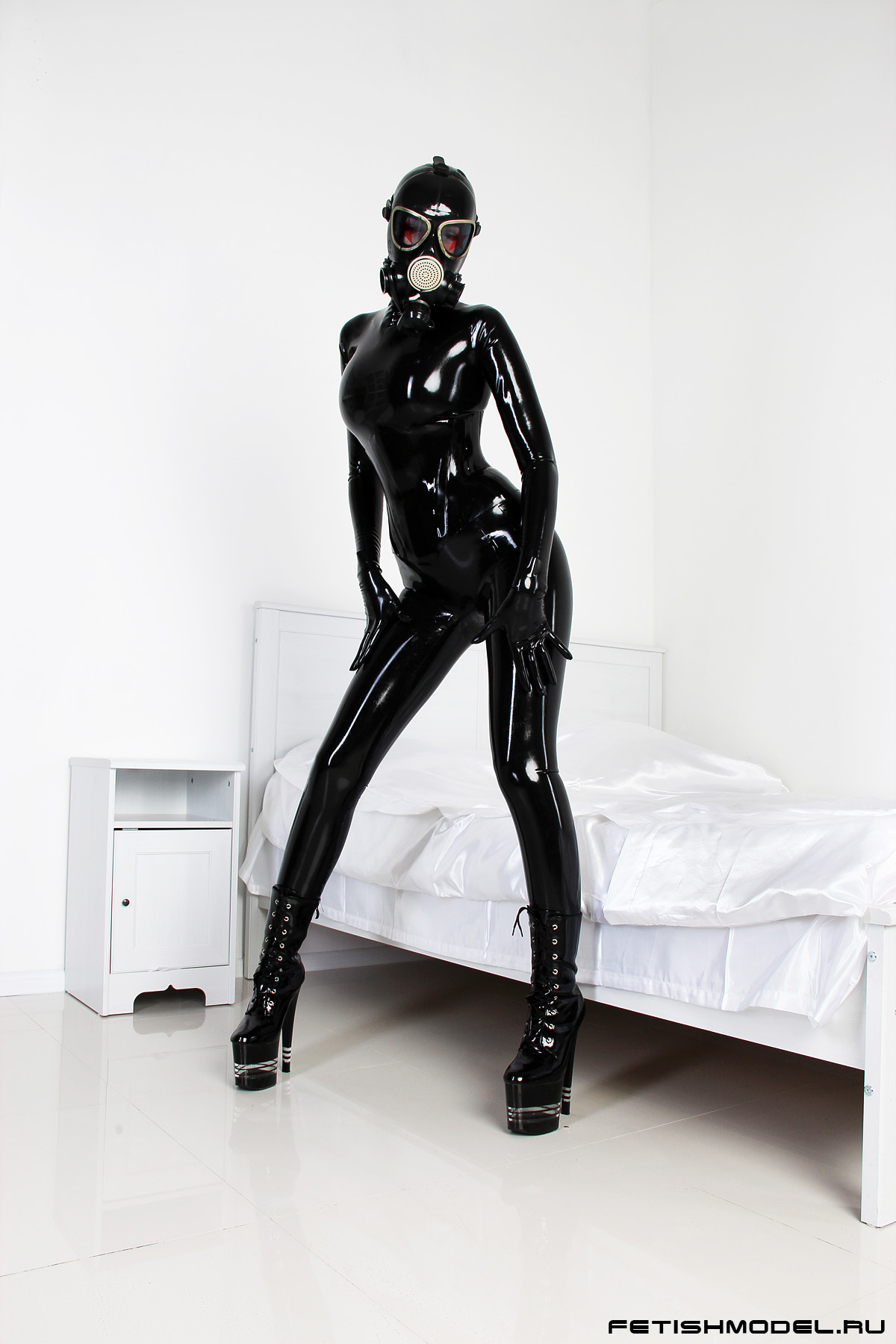 Black Latex Rubber Girl in a White Room. 2 by agnadeviphotographer