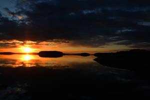 Sunset of Saimaa by Grymstiff