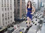 Giant Jennifer Lawrence walking against traffic.