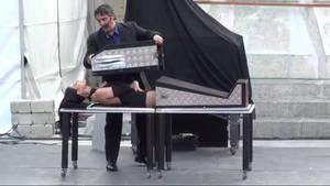 Aliskim lowers the 2nd box over her upper body