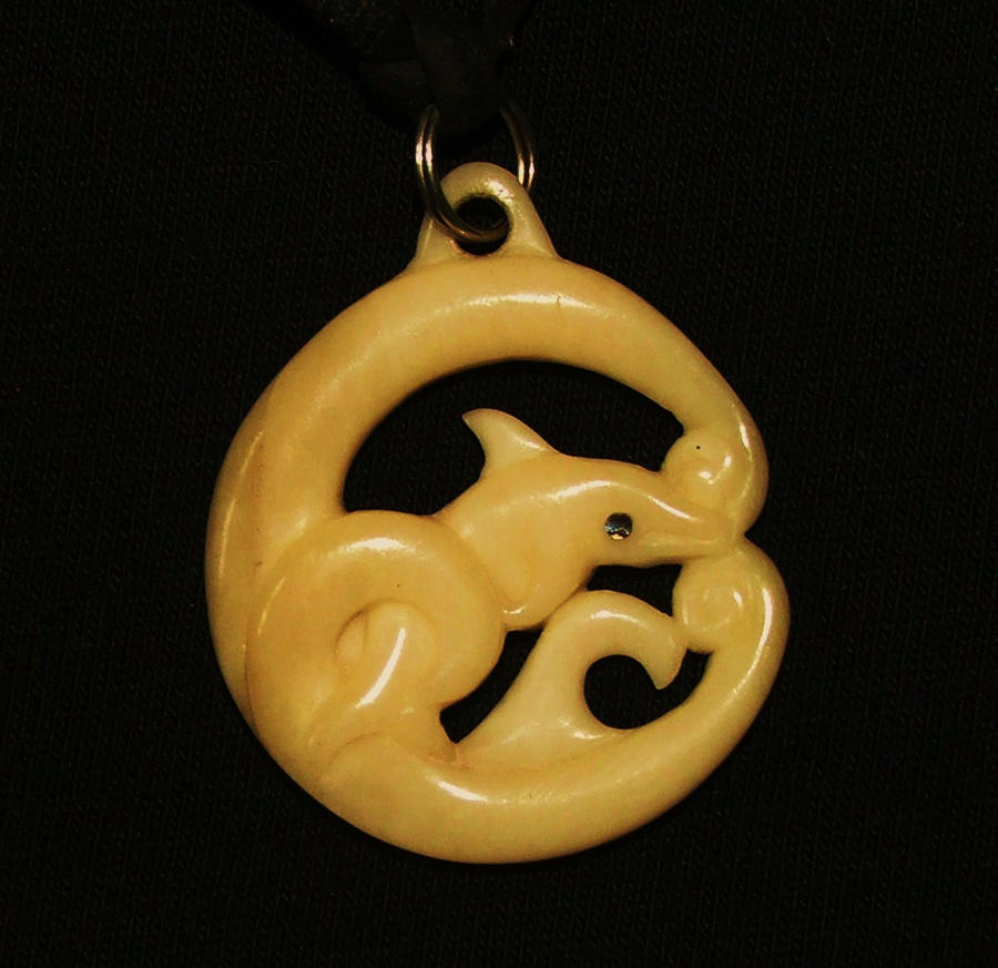 dolphin in the waves pendant by savagewerx