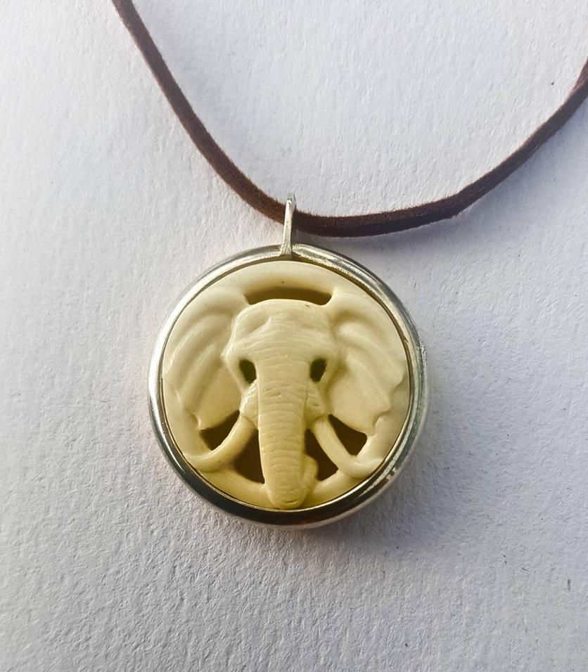 elephant head pendant by savagewerx