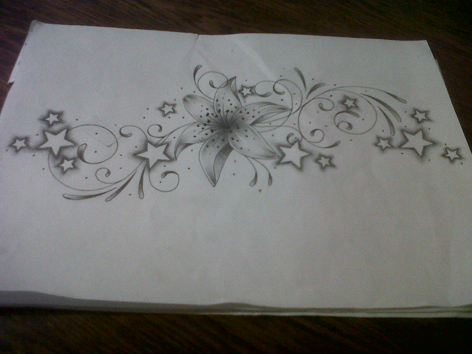 lily tattoo design with swirls and stars by tattoosuzette