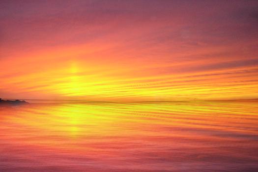 Sunset on reflective sea
