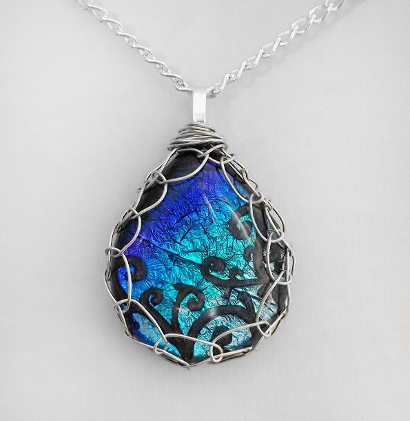 Blue framed glass pendant by honeycatjewelry on deviantart blue framed glass pendant by honeycatjewelry aloadofball Gallery