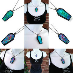Glass coffin necklaces