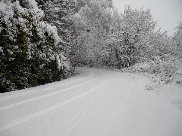 Snowy road by Socks1993