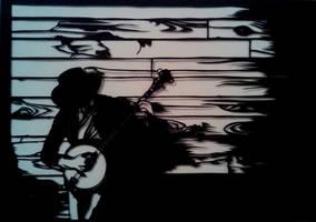 Banjo player paper cut