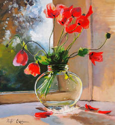 Poppies in a glass vase