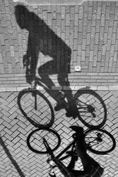 Shadow Of A Passing Biker by hariskalin