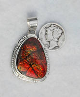 Shimering Red Ammolite Pendant. by FlagstaffTraders