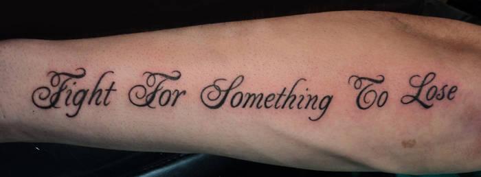 Swirly script tattoo
