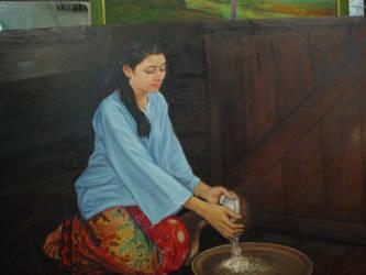 Grating coconut by AbdulRashid