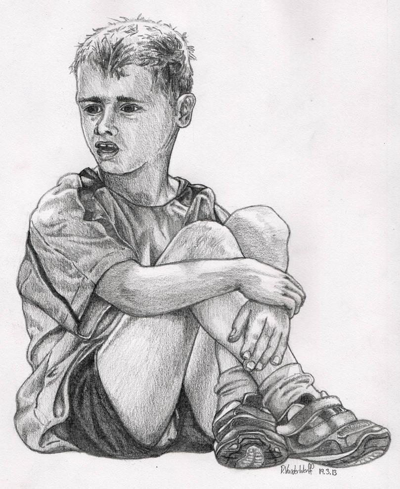 Boy Sitting With Crossed Legs