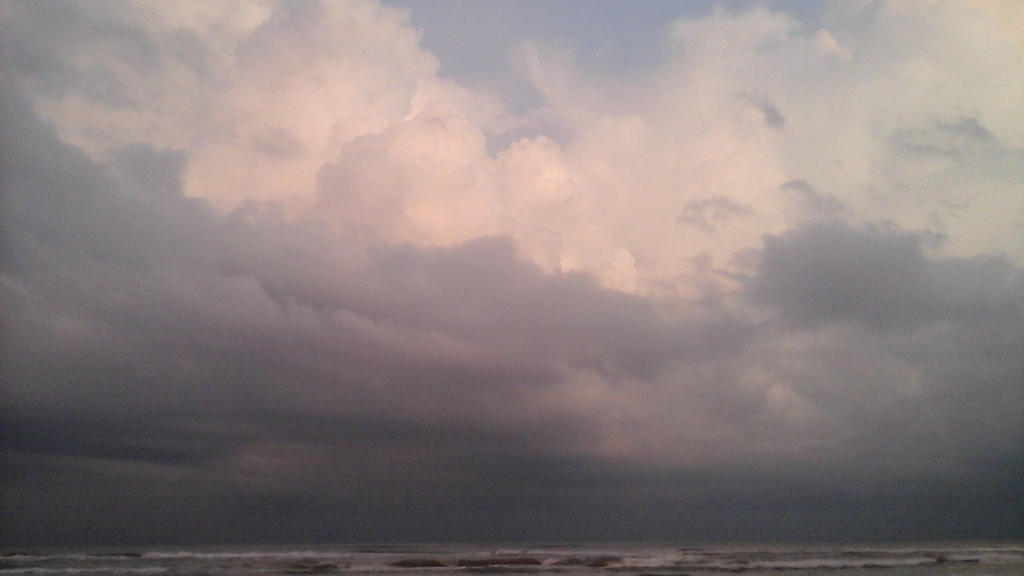 Storm clouds over the sea by Growlie26