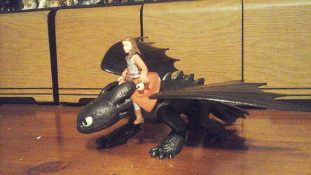 Lucy riding Toothless