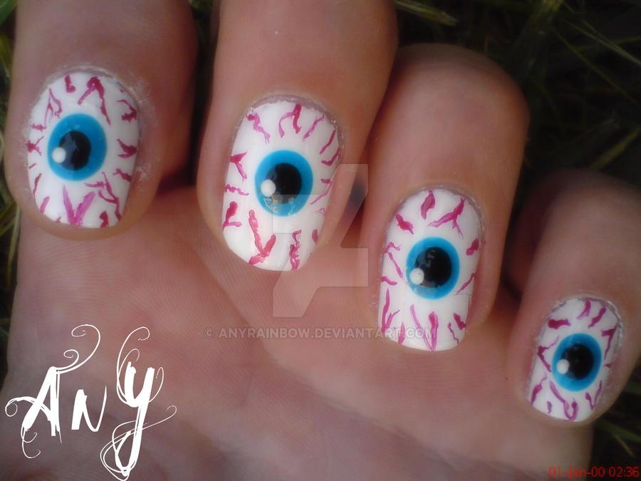 Рисунки глаз на ногтях