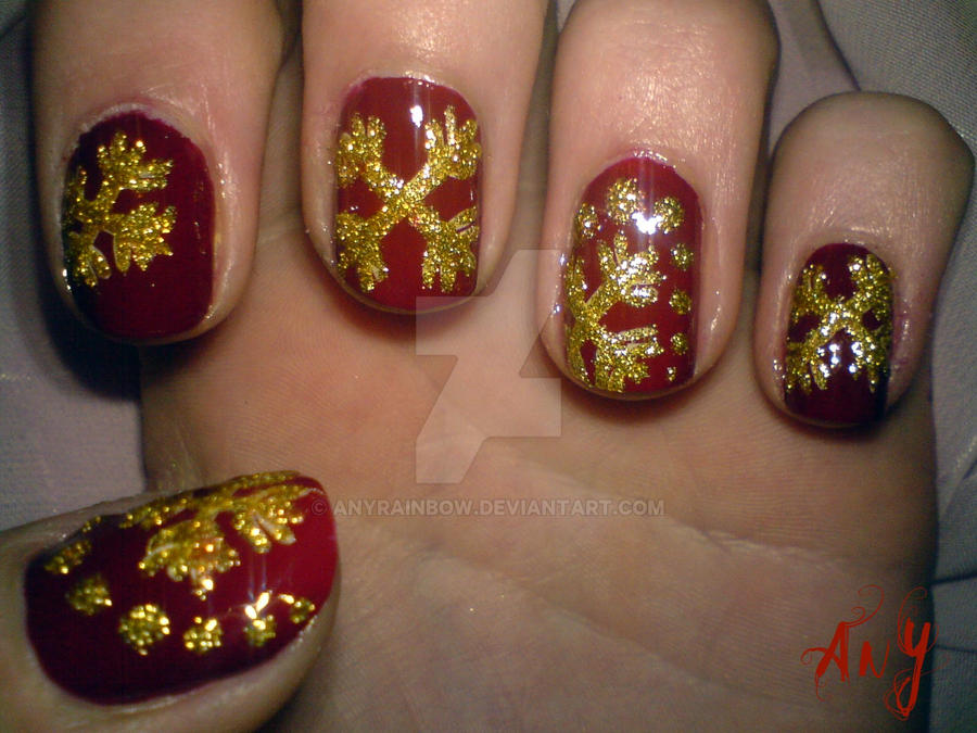Golden Snowflake Nail Design by AnyRainbow