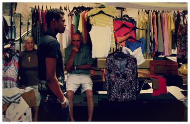 black man walks by by francescagalea