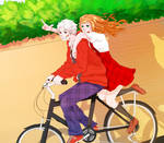 Gil and Eliza on a bicycle
