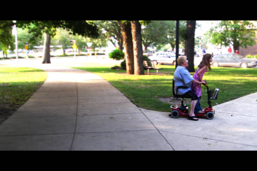 Lady and Girl On Scooter