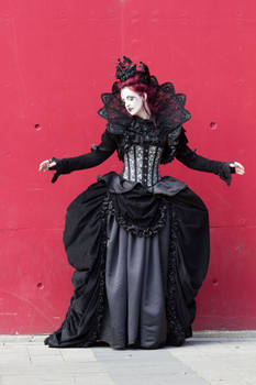 Stock - Gothic woman vampire red wall pose 1