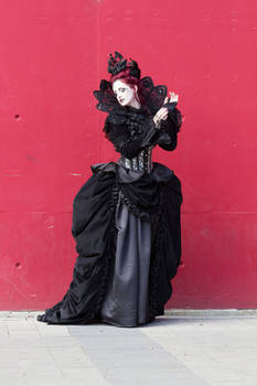 Stock - Gothic woman vampire red wall pose 3