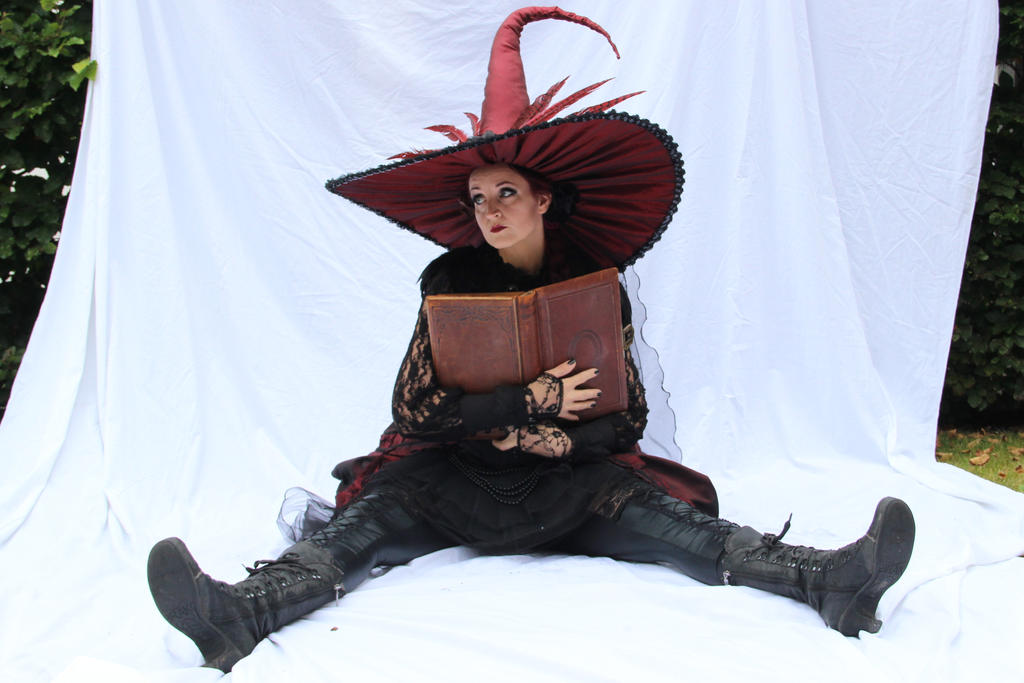 Stock - Witch sitting with a book 2