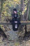 Stock - Gothic autumn lady sitting bridge pose 1