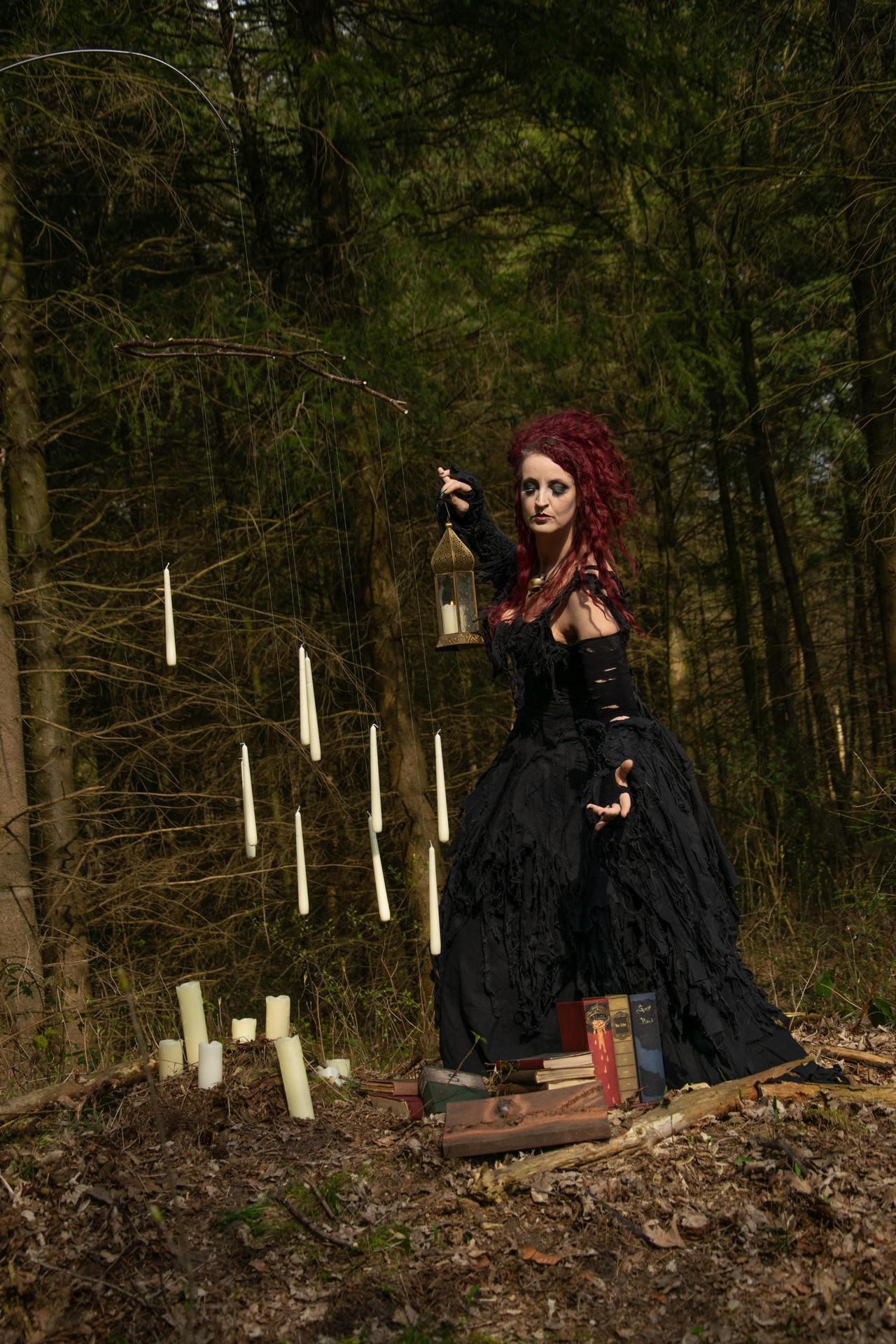 Stock - Bellatrix Lestrange holding lantern stand