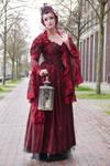 Stock - red dress lantern woman wave good-bye
