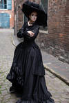 Stock - Gothic lady with a big hat stand romantic