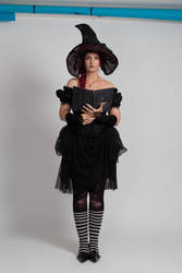 Stock - Halloween black witch book stand pose 2