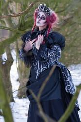 Stock - Spooky hold heart  pose woman burton