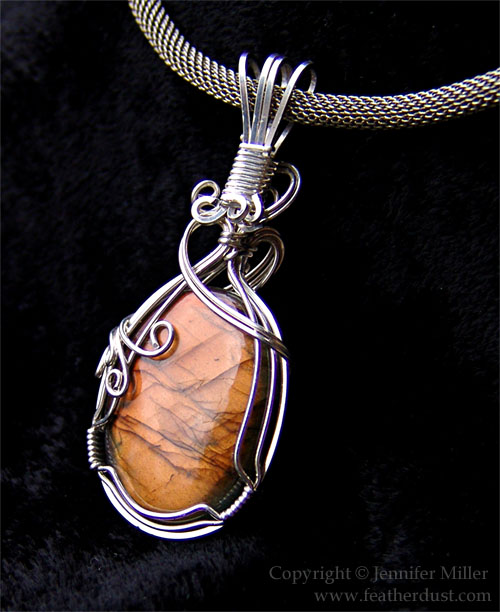 Vibrant Orange Labradorite by Nambroth