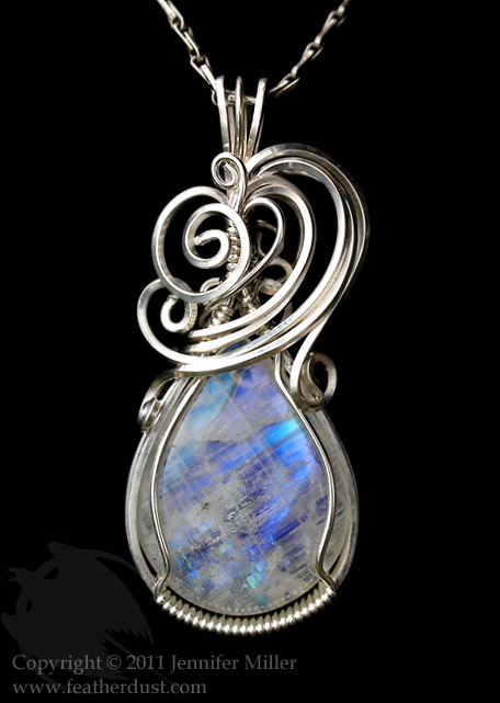Glacial fire moonstone pendant by nambroth on deviantart glacial fire moonstone pendant by nambroth mozeypictures Choice Image