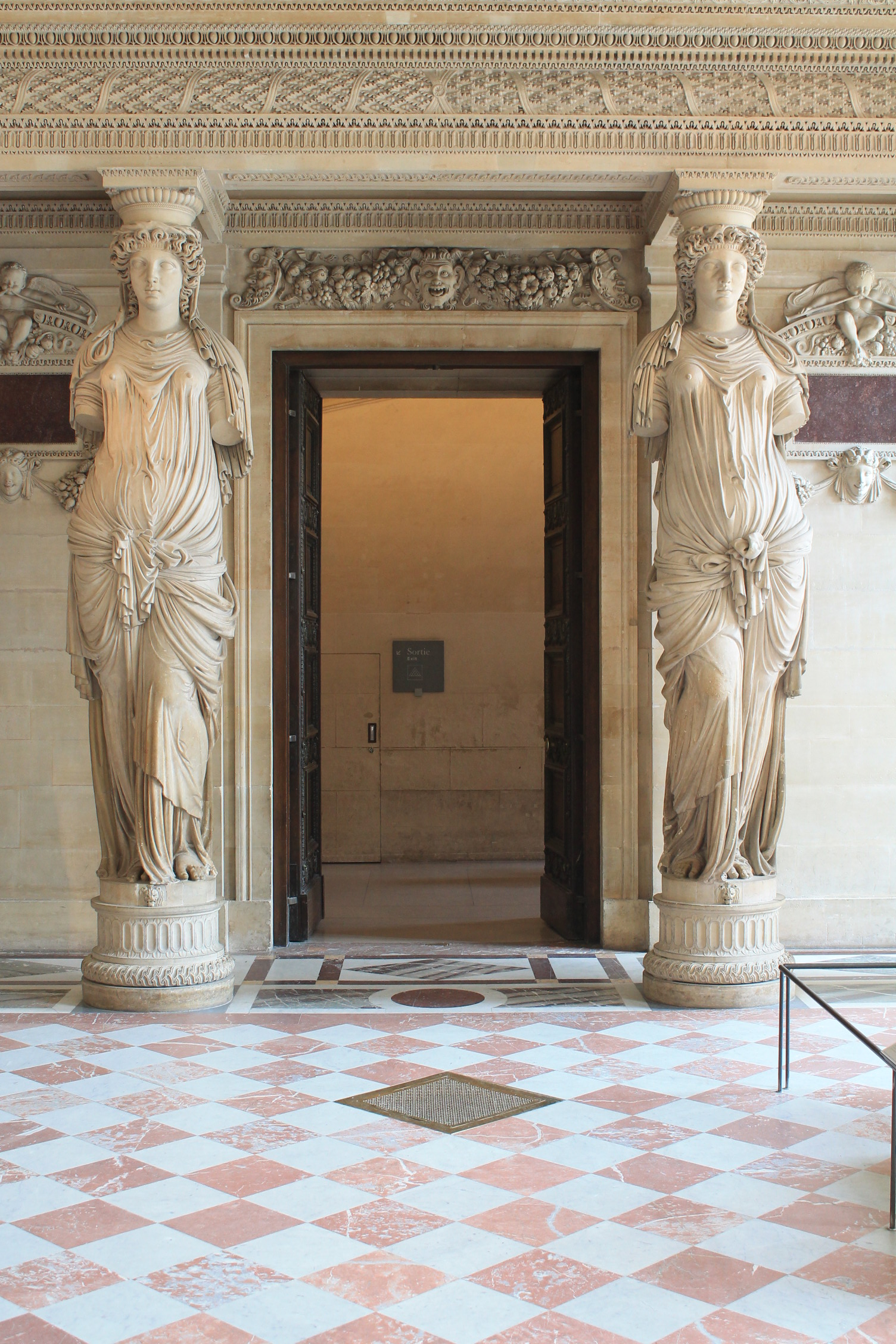Large Statues flanking door by Vinanti