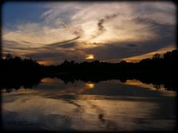 lake lakota at night with clouds by deamon-the-wolf