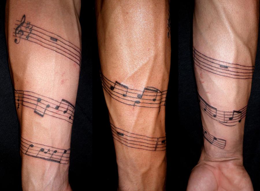 Musical arm by dreiii on deviantart for Music tattoos for guys