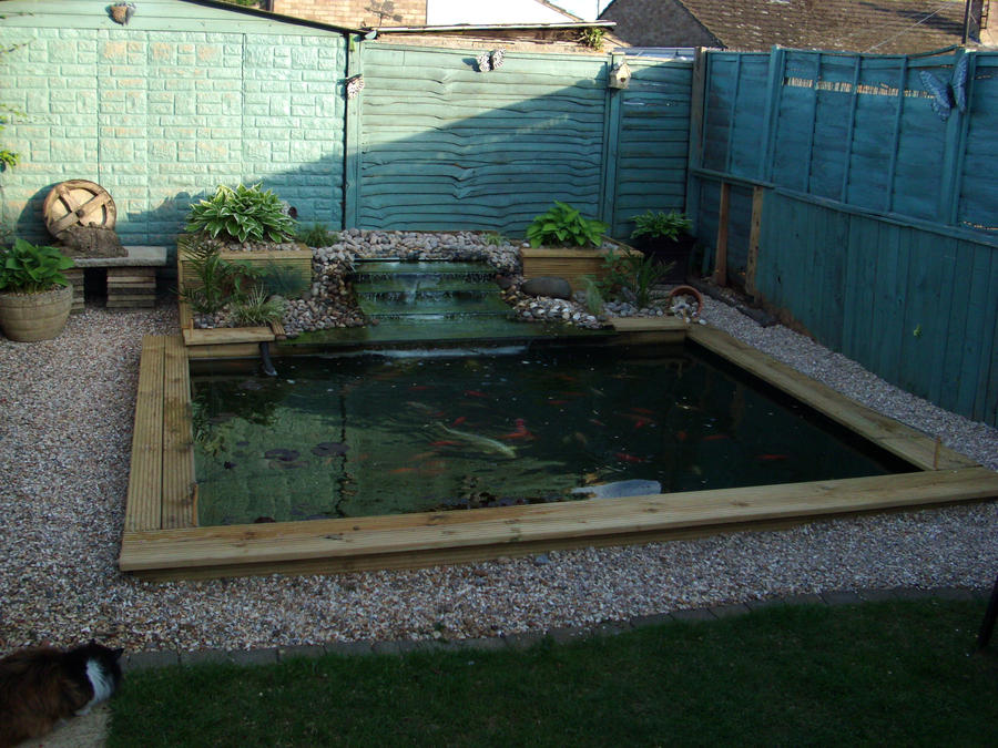 My dads homemade fishpond by ladysj on deviantart for Homemade koi pond